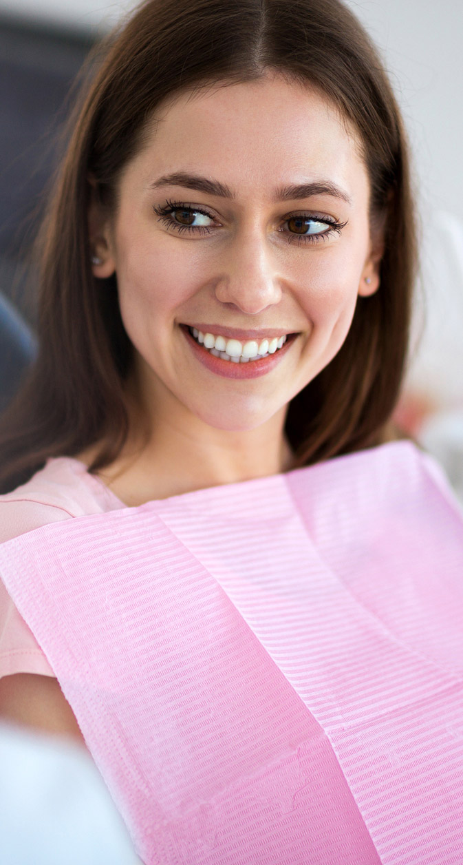 A woman smiles during her dental appointment